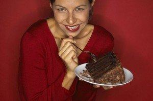 Woman eating a chocolate cake